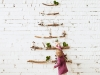 child baby touching christmas toy on decorated minimalistic modern trendy christmas tree